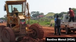 A worker uses heavy machinery as he works on the busy road connecting Kuacjok to Tharkueng in September 2014. Locals welcomed the repairs, which they say are vital to their and other road users' well being.
