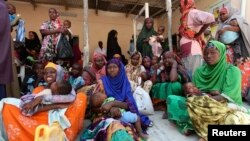 Internally displaced Somali women wait for medicine at a Save the Children UK clinic at their camp in Hodan district of Somalia's capital Mogadishu. (File)