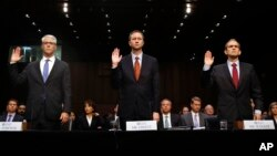 FILE - From left, Facebook's General Counsel Colin Stretch, Twitter's Acting General Counsel Sean Edgett, and Google's Senior Vice President and General Counsel Kent Walker, are sworn in for a Senate Intelligence Committee hearing on Russian election activity and technology, on Capitol Hill in Washington, Nov. 1, 2017. There were signs, some say telltale signs, of Russians using social media to meddle in the U.S. elections long before tech companies wised up to it. Could Facebook, Google and Twitter have caught the abuse earlier?