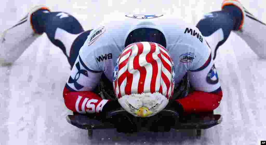 Katie Uhlaender of the United States reacts at the end of her run during the women's skeleton race at the Bobsleigh and Skeleton World Championships in Altenberg, Germany.