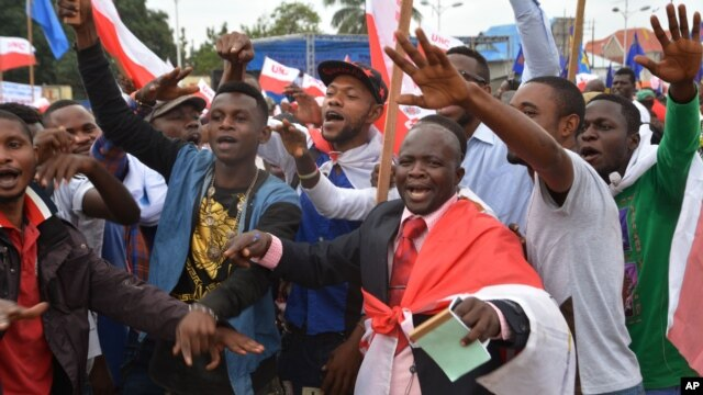 FILE - Congo opposition party supporters demonstrate during a rally against President Joseph Kabila running for president for a fourth term in Kinshasa, DRC, Sept. 15, 2015.