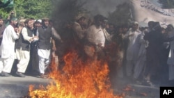 Protesters burn a US flag during a demonstration in Afghanistan's Jalalabad province, April 3, 2011, denouncing the burning last month of a copy of the Quran in a radical Florida church