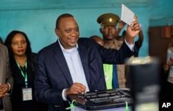 Kenya's President Uhuru Kenyatta casts his vote in his hometown of Gatundu, Kenya, Oct. 26, 2017.