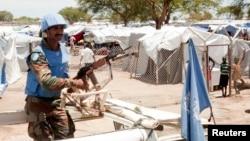 A U.N. peacekeeper keeps guard outside a refugee camp in Bor, South Sudan, on April 29, 2014.