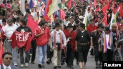 Ecuadorean Indians participate in a march to the capital city Quito to protest against the El Mirador copper mining project, in Cotopaxi, March 19, 2012.