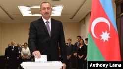 Azerbaijani President Ilham Aliyev casts his ballot at a polling station during a referendum in Baku, Azerbaijan, Sept. 26, 2016.
