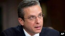 FILE - Puerto Rico Gov, Alejandro Javier Garcia Padilla testifies on Capitol Hill in Washington.