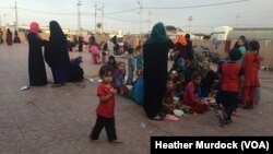 At a camp about 50 kilometers from the nearest fighting, families say they've fled Islamic State militants sometimes several times. They say new arrivals have a long wait for shelter in Iraqi Kurdistan, Oct. 20, 2016.