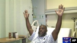 In this July 20, 2016, frame from video, Charles Kinsey explains in an interview from his hospital bed in Miami what happened when he was shot by police Monday.
