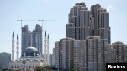Residential towers are seen next to the newly built Mimar Sinan mosque in Atasehir on the Asian side of Istanbul in this September 4, 2012 file photo.