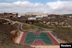 FILE - A basketball court is seen in the settler outpost of Amona, north of Ramallah, March 1, 2011.