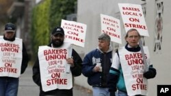 A small group of picketers from Bakery and Confectioners Workers Union Local 9 walk past a closed Hostess plant, Seattle, Nov. 16, 2012.