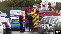 Members of emergency services arrive at the scene of a plane crash, which included members of Osama Bin Laden's family, at a car park next to Blackbushe Airport, in Hampshire, August 1, 2015.