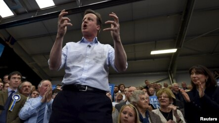 Britain's Prime Minister David Cameron addresses party activists at a campaign rally in Carlisle in northern England, May 6, 2015.
