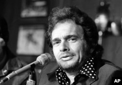 FILE - Country singer Merle Haggard is shown at a news conference in New York City, April 6, 1974.
