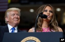 FILE - President Donald Trump looks to first lady Melania Trump as she introduces him during a rally at the Covelli Centre in Youngstown, Ohio, July 25, 2017.