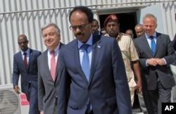 FILE - Somali president Mohamed Abdullahi Mohamed, centre, walks with UN Secretary-General Antonio Guterres, 2nd left, inside the UN compound in Mogadishu, Somalia, March 7, 2017.