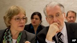 UN independent Commission of Inquiry members Karen Konig AbuZayd (left) and Paulo Pinheiro (right), the chairman, conferred about a recent report on human rights abuses in the Syrian war during a panel presentation in Geneva, Switzerland on September 17, 2012.