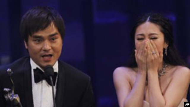 Actress JJ Jia, right, and producer Gordon Lam celebrates after winning the Best Film award for the movie 'Gallants' at the Hong Kong Film Awards in Hong Kong, Sunday, April 17, 2011.
