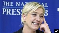 French presidential candidate Marine Le Pen speaks during a news conference at The National Press Club in Washington, Nov. 2, 2011.