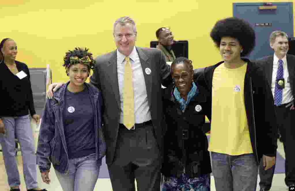 Democratic mayoral candidate Bill de Blasio embraces his family as they exit a polling station, Nov. 5, 2013 in the Park Slope neighborhood of the Brooklyn borough of New York. De Blasio is running against Republican candidate Joseph Lhota.