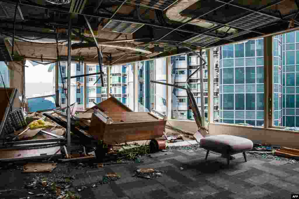 Panels and debris from a collapsed ceiling are seen in a company office of a commercial building in Hong Kong. Windows of the building were blown out during Typhoon Mangkhut in Hong Kong.