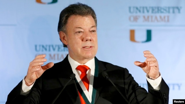 FILE - Colombia's President Juan Manuel Santos gestures as he addressed a gathering at the University of Miami in Coral Gables, Florida, Dec. 2, 2013.