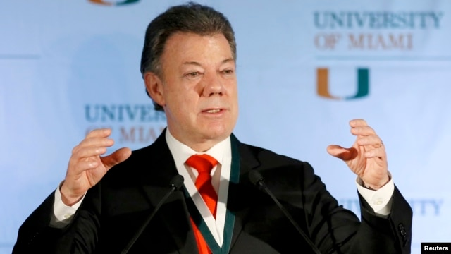 Colombia's President Juan Manuel Santos gestures as he addressed a gathering at the University of Miami in Coral Gables, Florida, Dec. 2, 2013.