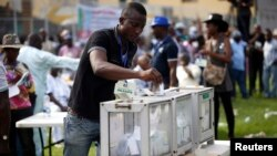 A party delegate casts his vote during the All Progressives Congress (APC) primary election to choose the party's governorship candidate for Lagos state, at Onikan stadium in Lagos, Dec. 4, 2014.