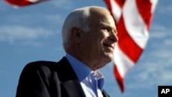 FILE - Republican presidential candidate Sen. John McCain, R-Ariz. speaks at a rally outside Raymond James Stadium in Tampa, Florida, Nov. 3, 2008.