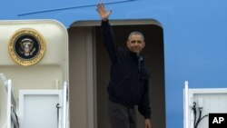 President Barack Obama waves as he boards Air Force One, Saturday, May 21, 2016, at Andrews Air Force Base, Md. on his way to Vietnam. (AP Photo/Evan Vucci)