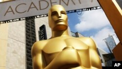 FILE - An Oscar statue appears outside the Dolby Theatre for the Academy Awards in Los Angeles.