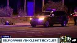 A still image taken from video provided by ABC-15, shows investigators at the scene of a fatal accident involving a self-driving Uber car on the street in Tempe, Arizona, March 19, 2018. .