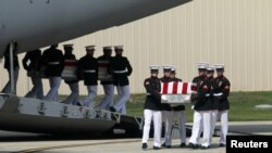 The remains of Americans killed in Benghazi this week are taken off a transport aircraft