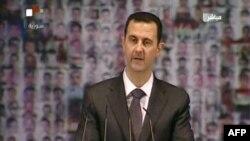 Tổng thống Syria Bashar al-Assad đọc diễn văn toàn quốc ngày 6/1/2013.
