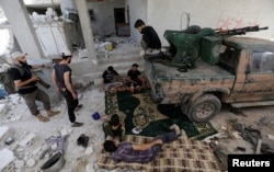 Rebel fighters from Jaysh al-Sunna, operating under a coalition of rebel groups called Jaish al-Fatah, or the army of conquest, rest in Aziziyah village, southern Aleppo countryside, Syria, May 17, 2016.