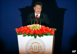 Chinese President Xi Jinping speaks during the opening ceremony of the Asian Infrastructure Investment Bank (AIIB) in Beijing Saturday, Jan. 16, 2016.