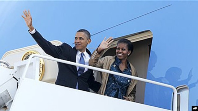 President Barack Obama and first lady Michelle Obama waves as they board Air Force One at Andrews Air Force Base, MD as they begin their trip to Asia. The president will visit India, Indonesia, South Korea, and Japan, 5 Nov 2010