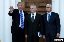 U.S. President-elect Donald Trump and Vice President-elect Mike Pence greet retired Marine General James Mattis for a meeting at the main clubhouse at Trump National Golf Club in Bedminster, New Jersey, Nov. 19, 2016.