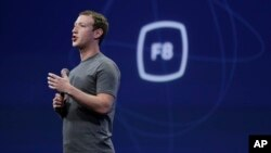 "FILE - In this March 25, 2015, file photo, CEO Mark Zuckerberg gestures while delivering the keynote address at the Facebook F8 Developer Conference in San Francisco. On Sept. 15, Zuckerberg said Facebook may finally be getting a button that lets you quickly express something beyond a ""like."""