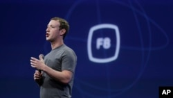 "CEO Mark Zuckerberg gestures while addressing a Facebook Developer Conference in San Francisco, California, March 25, 2015. On Wednesday, he is to meet with ""conservative thought leaders"" amid reports Facebook excluded conservative news from its ""trending topics"" section."