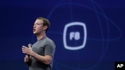 FILE - In this March 25, 2015, file photo, CEO Mark Zuckerberg gestures while delivering the keynote address at the Facebook F8 Developer Conference in San Francisco.