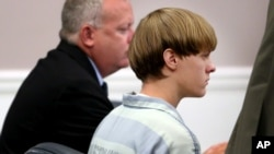 FILE - Dylann Roof appears at a court hearing in Charleston, South Carolina, July 16, 2015.