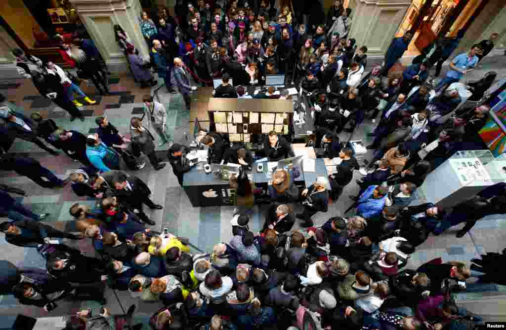 Customers gather at a store selling Apple products during the launch of the new iPhone 7 sales at the State Department Store, GUM, in central Moscow, Russia.