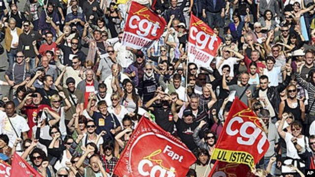 Followers of the CGT Union (General Confederation of Work) attend a protest march in Marseille, southern France, over the government's attempt to raise the retirement age by two years to save money, 12 Oct 2010