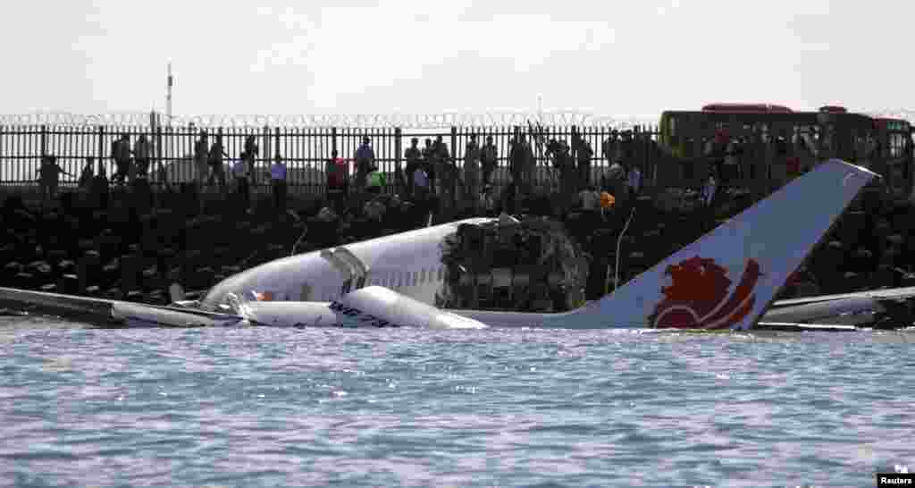 The wreckage of a Lion Air Boeing 737 -800 airplane is seen in the water near Ngurah Rai airport in Denpasar, Bali, Indonesia, Apr. 14, 2013.