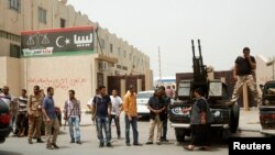 Members of armed revolutionaries stage a protest in front of the Libyan Justice Ministry in Tripoli, April 30, 2013.