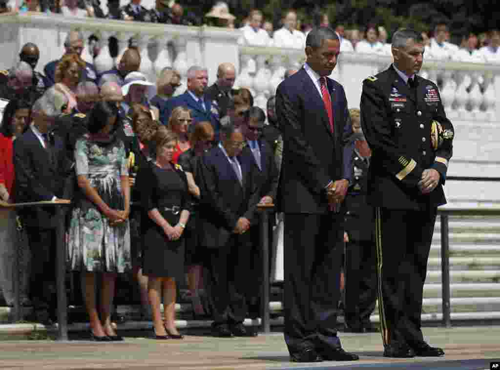 President Obama lowers his head during a wreath-laying cermony at the Tomb of the Unknowns in Arlington National Cemetery in Arlington, Virginia, May 28, 2012.