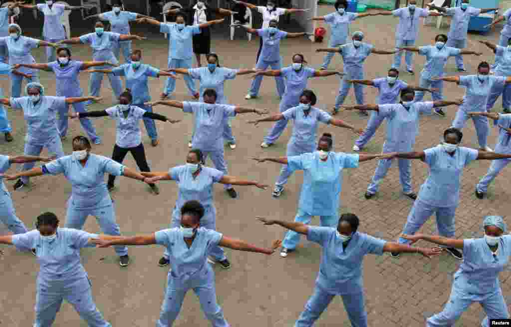 Nurses participate in a Zumba fitness program as a way of helping them to deal with working situations during the coronavirus crisis, within the Infectious Disease Unit grounds of the Kenyatta National Hospital in Nairobi, Kenya.