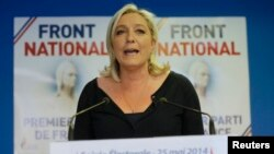 Marine Le Pen, France's National Front political party head, reacts to results after the polls closed in the European Parliament elections at the party's headquarters in Nanterre, near Paris, May 25, 2014.